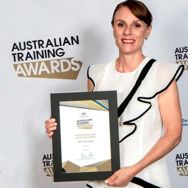 Jane Goodfellow holding her Australian VET Teacher/Trainer of the Year Award